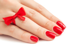 fingers with red manicure isolated